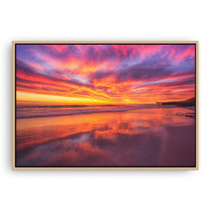 Rich, colourful sunset at North Beach in Western Australia framed canvas in raw oak