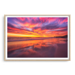 Rich, colourful sunset at North Beach in Western Australia framed in raw oak