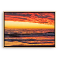 Rich sunset from North Beach in Perth, Western Australia framed canvas in raw oak