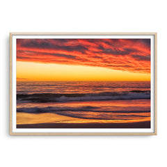Rich sunset from North Beach in Perth, Western Australia framed in raw oak