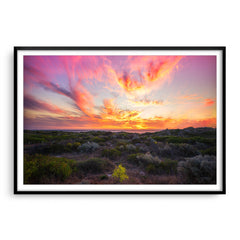 Warm, magenta sunset at Mullaloo Beach in Perth, Western Australia framed in black