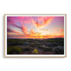 Warm, magenta sunset at Mullaloo Beach in Perth, Western Australia framed in raw oak