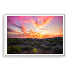Warm, magenta sunset at Mullaloo Beach in Perth, Western Australia framed in white