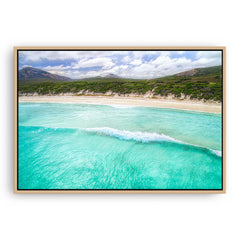 Aerial view of wave rolling into the beach at Hellfire Bay, Western Australia framed canvas in raw oak