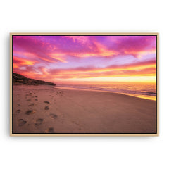 Sunset footprints at North Beach, Perth, Western Australia framed canvas in raw oak