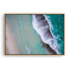 Aerial view of waves breaking at Eleven Mile Beach in Esperance, Western Australia framed canvas in raw oak