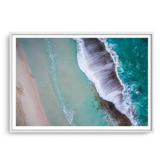 Aerial view of waves breaking at Eleven Mile Beach in Esperance, Western Australia framed in white