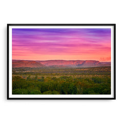 Colourful layered sky over the El Questro Wilderness Park in the Kimberley, Western Australia framed in black
