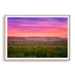 Colourful layered sky over the El Questro Wilderness Park in the Kimberley, Western Australia framed in raw oak