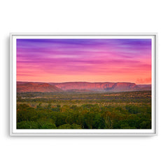 Colourful layered sky over the El Questro Wilderness Park in the Kimberley, Western Australia framed in white