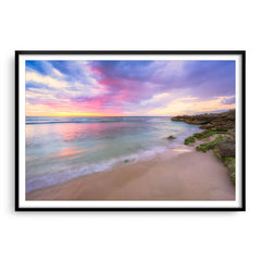 Pastel coloured sunset at Mettams Pool in Perth, Western Australia framed in black