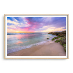 Pastel coloured sunset at Mettams Pool in Perth, Western Australia framed in raw oak