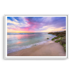 Pastel coloured sunset at Mettams Pool in Perth, Western Australia framed in white