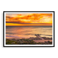 Smoke filled sunset over North Beach Jetty in Perth, Western Australia framed in black