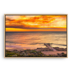 Smoke filled sunset over North Beach Jetty in Perth, Western Australia framed canvas in raw oak