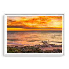 Smoke filled sunset over North Beach Jetty in Perth, Western Australia framed in white
