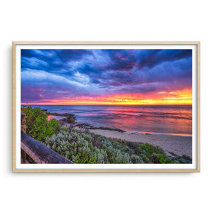 Colourful sunset over Mettams Pool in Perth, Western Australia framed in raw oak