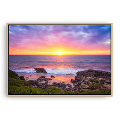 Beautiful sunset at Trigg Beach in Perth, Western Australia framed canvas in raw oak