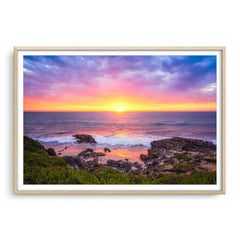 Beautiful sunset at Trigg Beach in Perth, Western Australia framed in raw oak