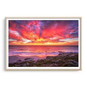 Incredible red sunset over North Beach Jetty in Perth, Western Australia framed in raw oak