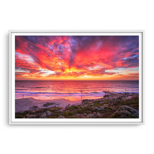 Incredible red sunset over North Beach Jetty in Perth, Western Australia framed in white