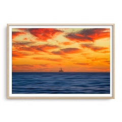 Armageddon oil rig at sunset in Perth, Western Australia framed in raw oak