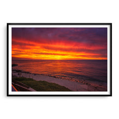 Fiery skies over Mettams Pool in Perth, Western Australia framed in black
