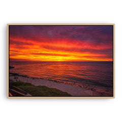 Fiery skies over Mettams Pool in Perth, Western Australia framed canvas in raw oak