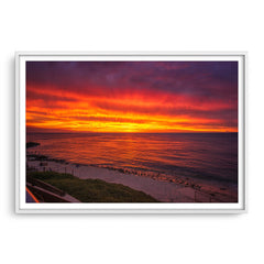 Fiery skies over Mettams Pool in Perth, Western Australia framed in white