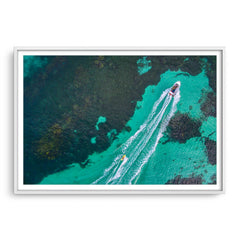Aerial view of water skier in Augusta, Western Australia framed in white