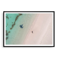 Aerial view of stingray swimming in the shallow waters of Sandy Cape, Western Australia framed in black