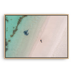 Aerial view of stingray swimming in the shallow waters of Sandy Cape, Western Australia framed canvas in raw oak