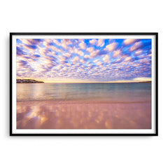 Cotton candy clouds over Sandy Cape in Western Australia framed in black