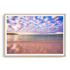 Cotton candy clouds over Sandy Cape in Western Australia framed in raw oak