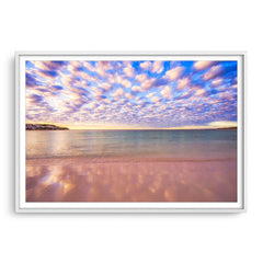 Cotton candy clouds over Sandy Cape in Western Australia framed in white