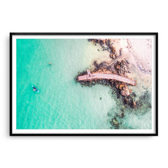 Aerial view of SUP in Augusta, Western Australia framed in black