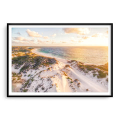 Aerial view of sunset over the sand dunes at Sandy Cape in Western Australia framed in black