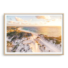 Aerial view of sunset over the sand dunes at Sandy Cape in Western Australia framed in raw oak