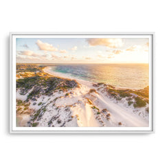 Aerial view of sunset over the sand dunes at Sandy Cape in Western Australia framed in white