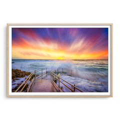 Colourful stormy sunset at Mettams Pool in Perth, Western Australia framed in raw oak