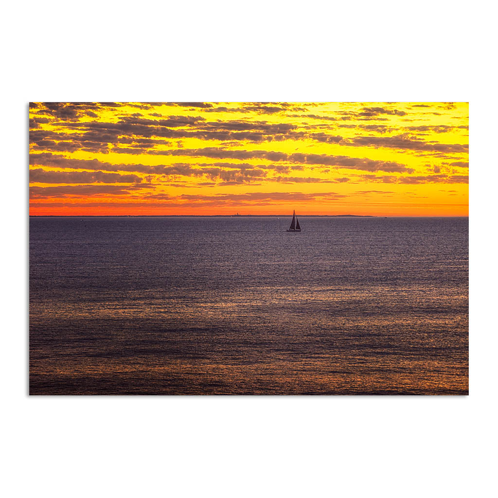 Boat sailing past rottnest island at sunset in Perth, Western Australia