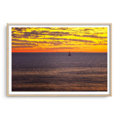 Boat sailing past rottnest island at sunset in Perth, Western Australia framed in raw oak