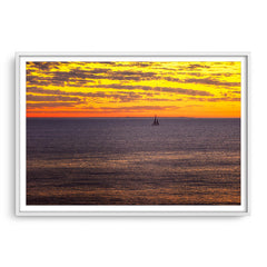 Boat sailing past rottnest island at sunset in Perth, Western Australia framed in white