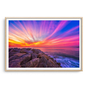 Stunning sunset over Cottesloe Beach in Perth, Western Australia framed in raw oak