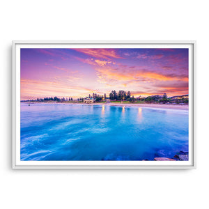 Blue waters and magenta skies over Cottesloe in Perth, Western Australia framed in white