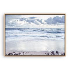 Grey skies over trigg Beach in Perth, Western Australia framed canvas in raw oak