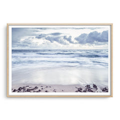 Grey skies over trigg Beach in Perth, Western Australia framed in raw oak