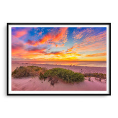 Summer sunsets over Scarborough Beach in Perth, Western Australia framed in black