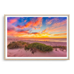 Summer sunsets over Scarborough Beach in Perth, Western Australia framed in raw oak