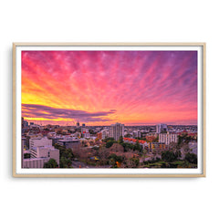 Sunset over East Perth in Western Australia framed in raw oak